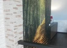 Оформление стены на мансардном этаже
